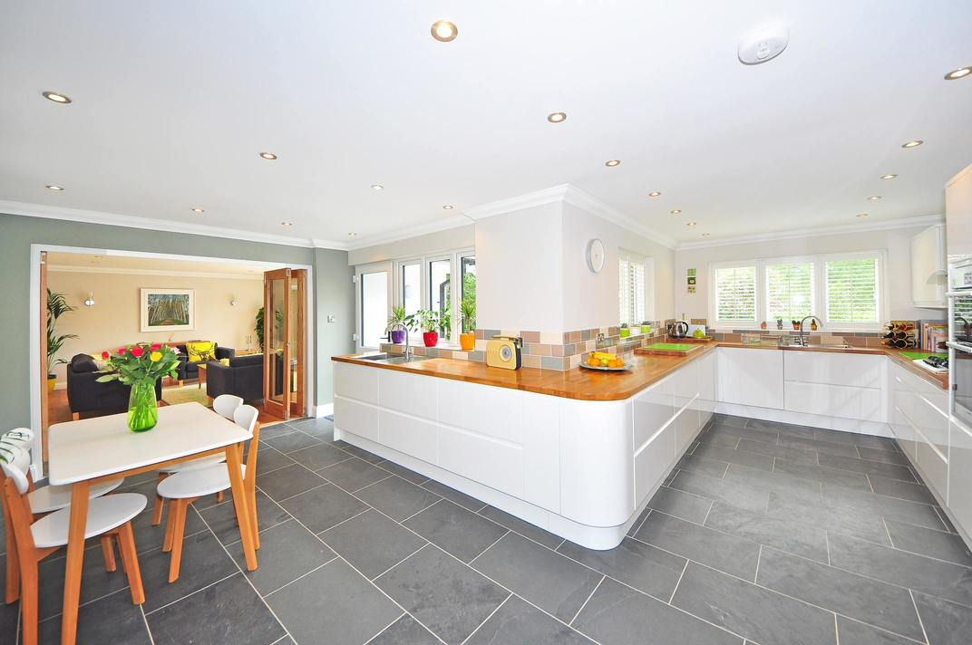 An image of a large kitchen on the ground floor of a home which has been extended.